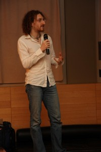 "In a button-down white shirt and jeans, Maymay prepares for a five minute ""lightning talk"" at Ignite Sydney in 2009."