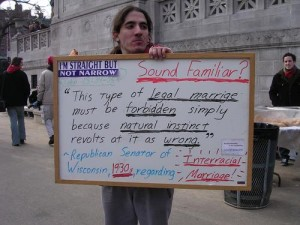 A same-sex marriage counter-protestor holds a poignant sign.